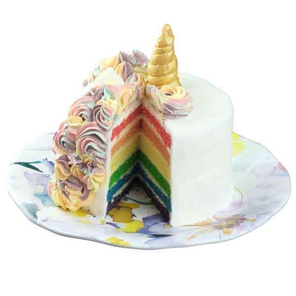 Rainbow cake layers of a luxury unicorn birthday cake
