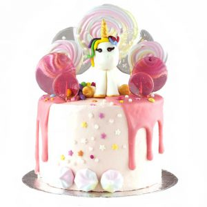 Magical children's celebration cake with unicorn and lollipops