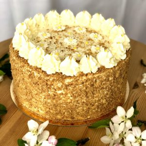 Luxury handcrafted golden honey cake with icing