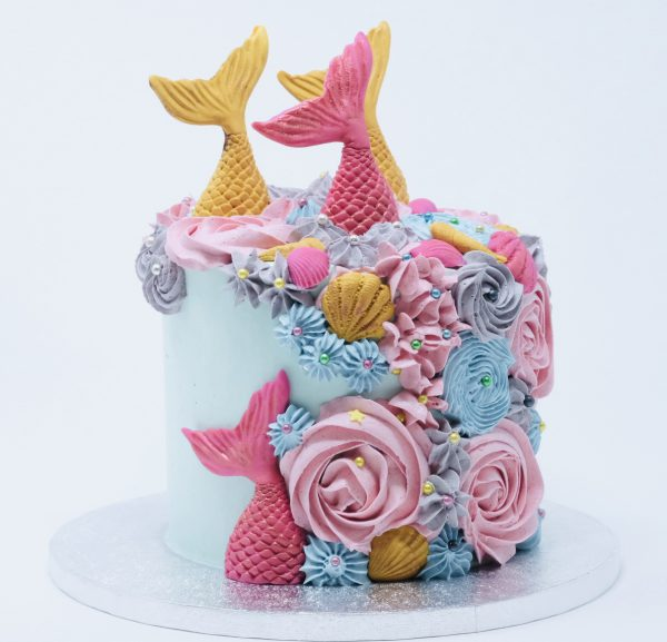 Vibrant rainbow gourmet mermaid childrens celebration cake