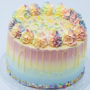 Unique luxury colourful rainbow birthday drip cake
