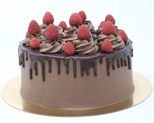 Luxury handcrafted chocolate ganache drip cake topped with strawberries