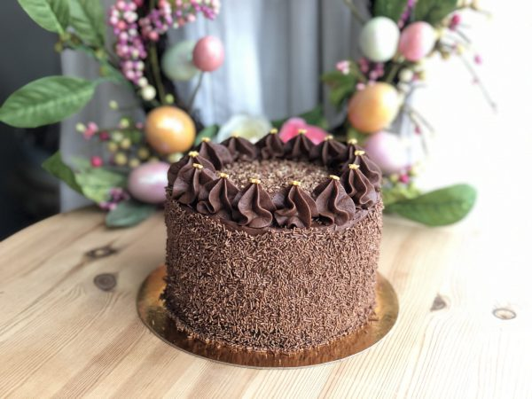 Indulgent handcrafted artisan chocolate cake with chocolate ganache
