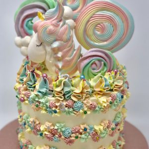 Unique colourful gourmet childrens birthday cake with unicorn and lolly