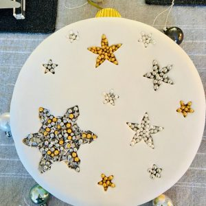 Classic gourmet Christmas cake with snowflakes and stars