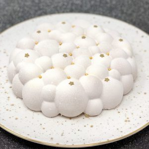 Unique handmade white Christmas cloud cake topped with stars