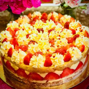 Freshly baked fraisier gateau with fresh cream and strawberries