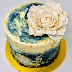 Beautiful showstopping galaxy celebration cake with white peony flower