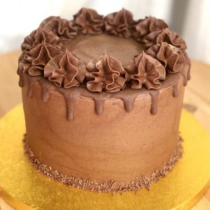 Rich and decadent chocolate ganache celebration cake with drip topping