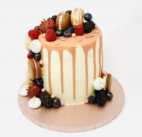 Peach and Prosecco handmade birthday cake with fruits and drip detail