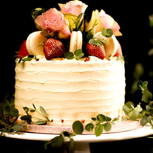 Wedding cake with macarons and strawberries
