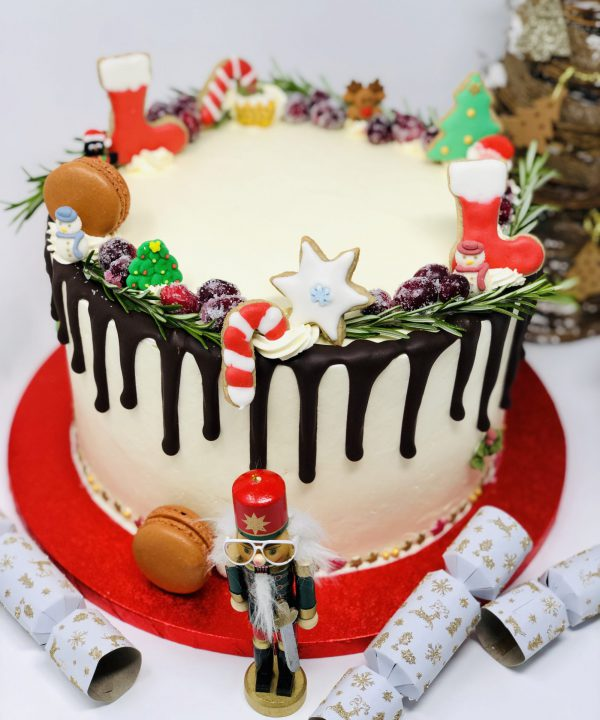 Festive Christmas cake handcrafted with christmas decorations